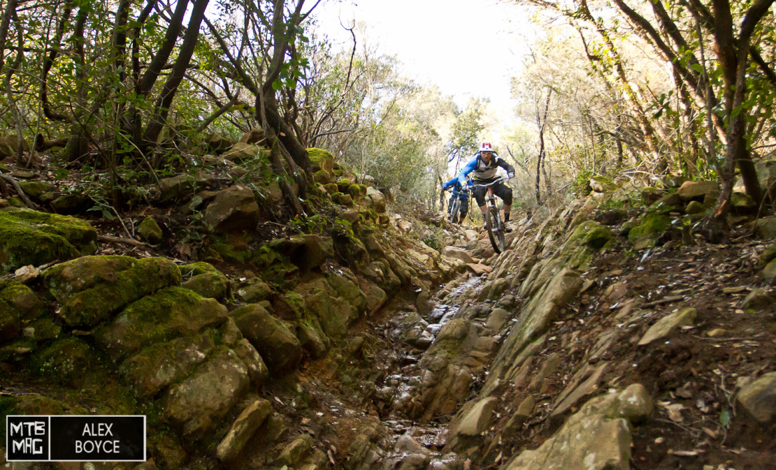 The trail then drops into a wide formed rocky channel that tests all elements of the bike.