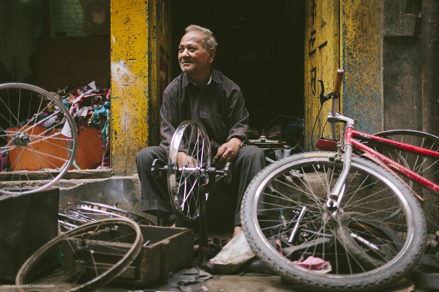 local bike mechanic, 40+ years at the job, wheel truer, kathmandu, nepal.