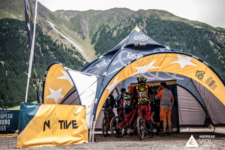 Competitors checking their times in the finish area during the 3rd stop of the European Enduro Series at Reschenpass, Austria, on July 26, 2015. Free image for editorial usage only: Photo by Andreas Vigl