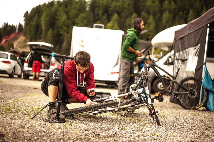 Competitors in the pit area at the 3rd stop of the European Enduro Series at Reschenpass, Austria, on July 25, 2015. Free image for editorial usage only: Photo by Andreas Vigl
