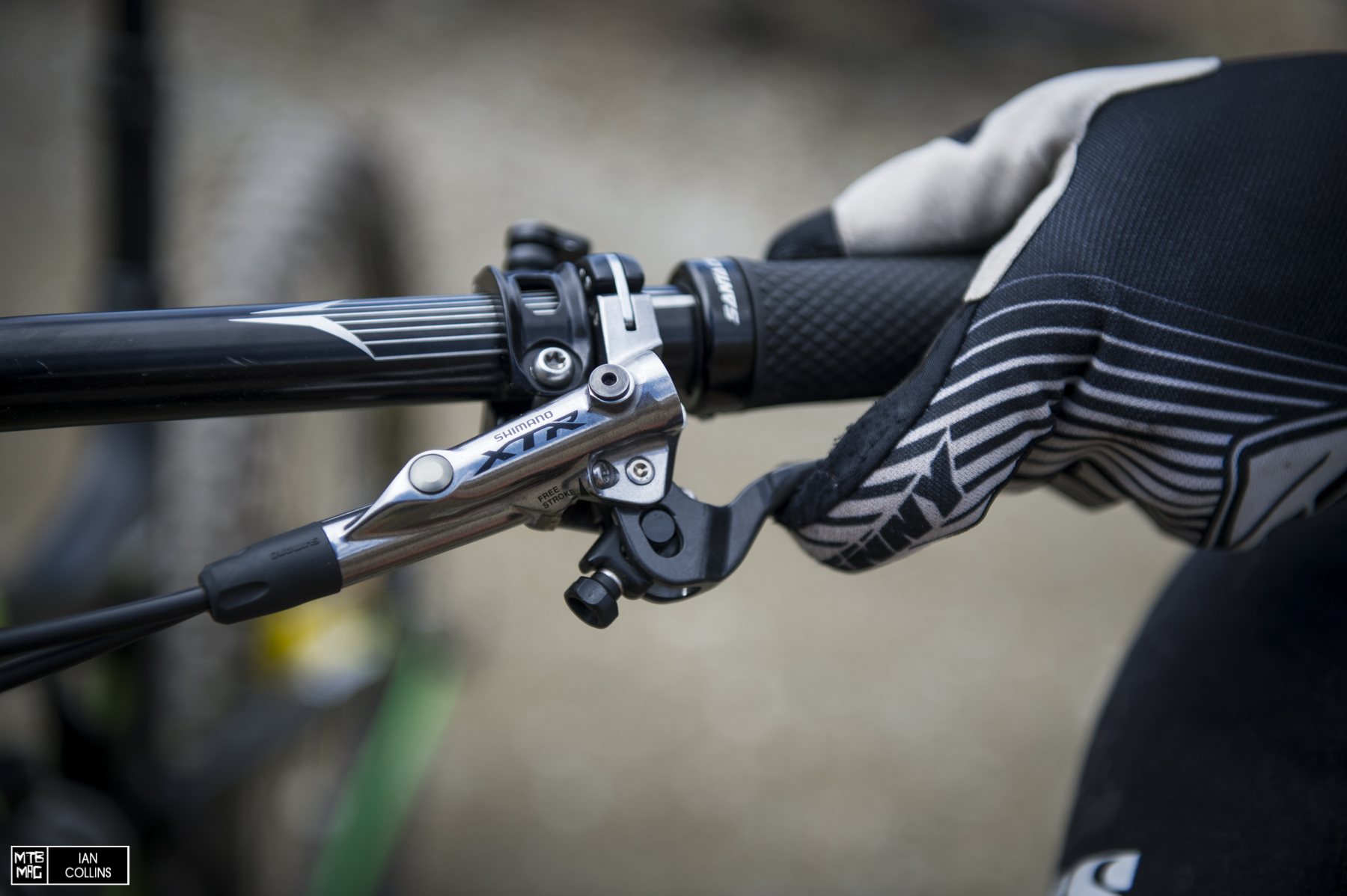 XTR levers keep it light, Saint calipers keep it strong.