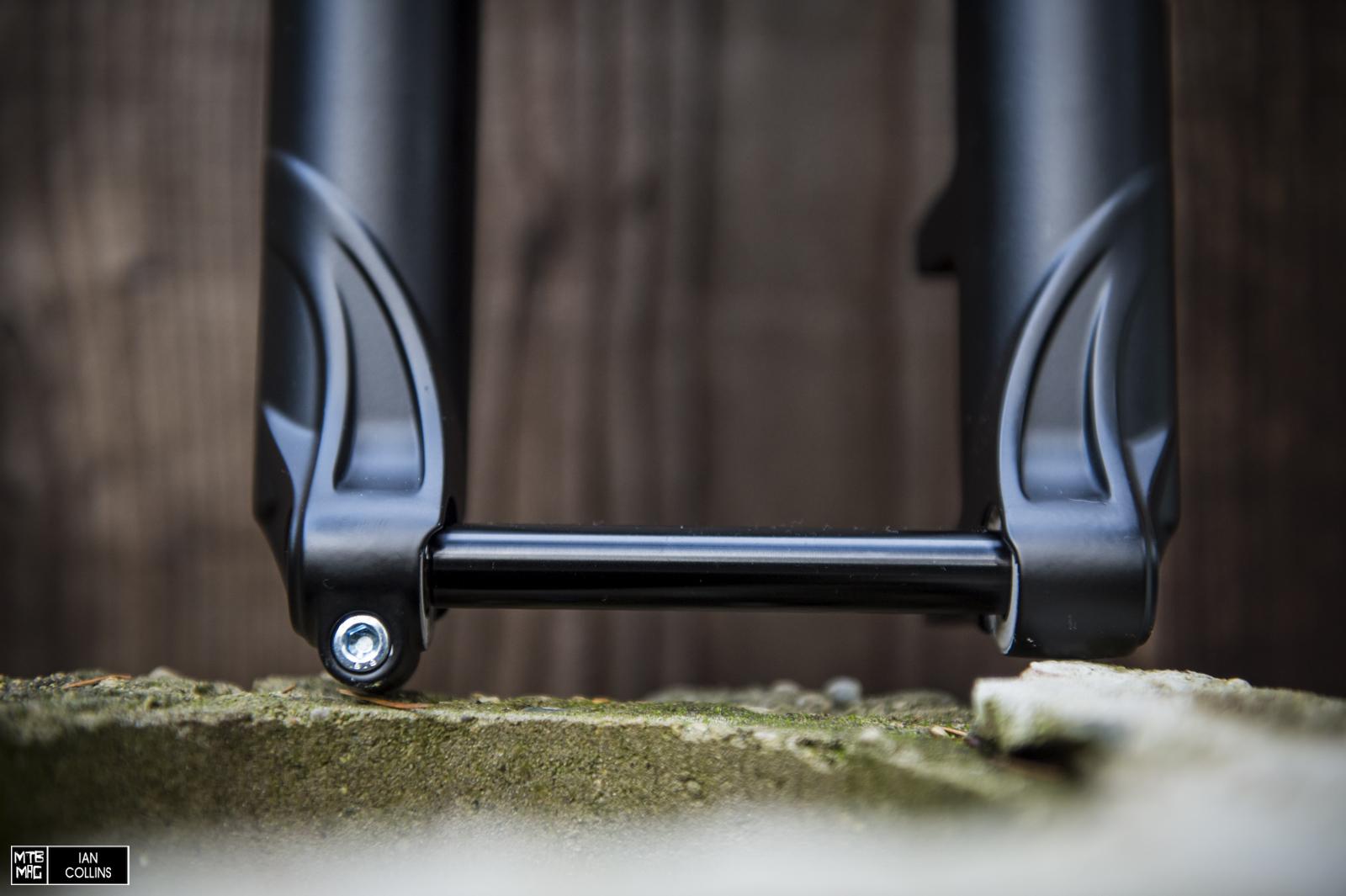 Single side pinch bolt. Keep it simple.