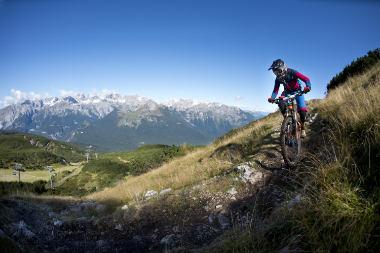 Franziska Meyer of GER in front of the impressive panorama of the Brenta mountains in the Dolomites. Stage 3 at the 4th stop of the European Enduro Series at Molveno-Paganella, Italy on September 06, 2015. Free image for editorial usage only: Photo by Manfred Stromberg