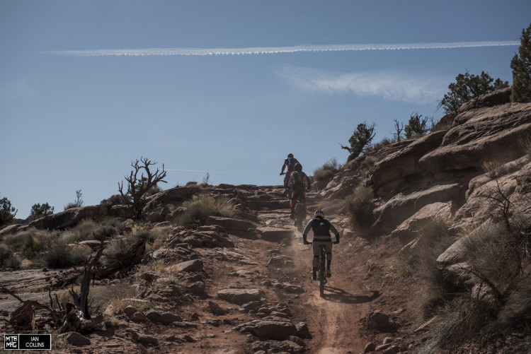 Sam Benedict from Specialized chases down a couple of motos on Amasa Back