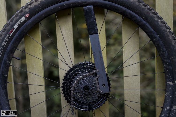 Use a chainwhip to lock the top and bottom cog sets together rotating clockwise.
