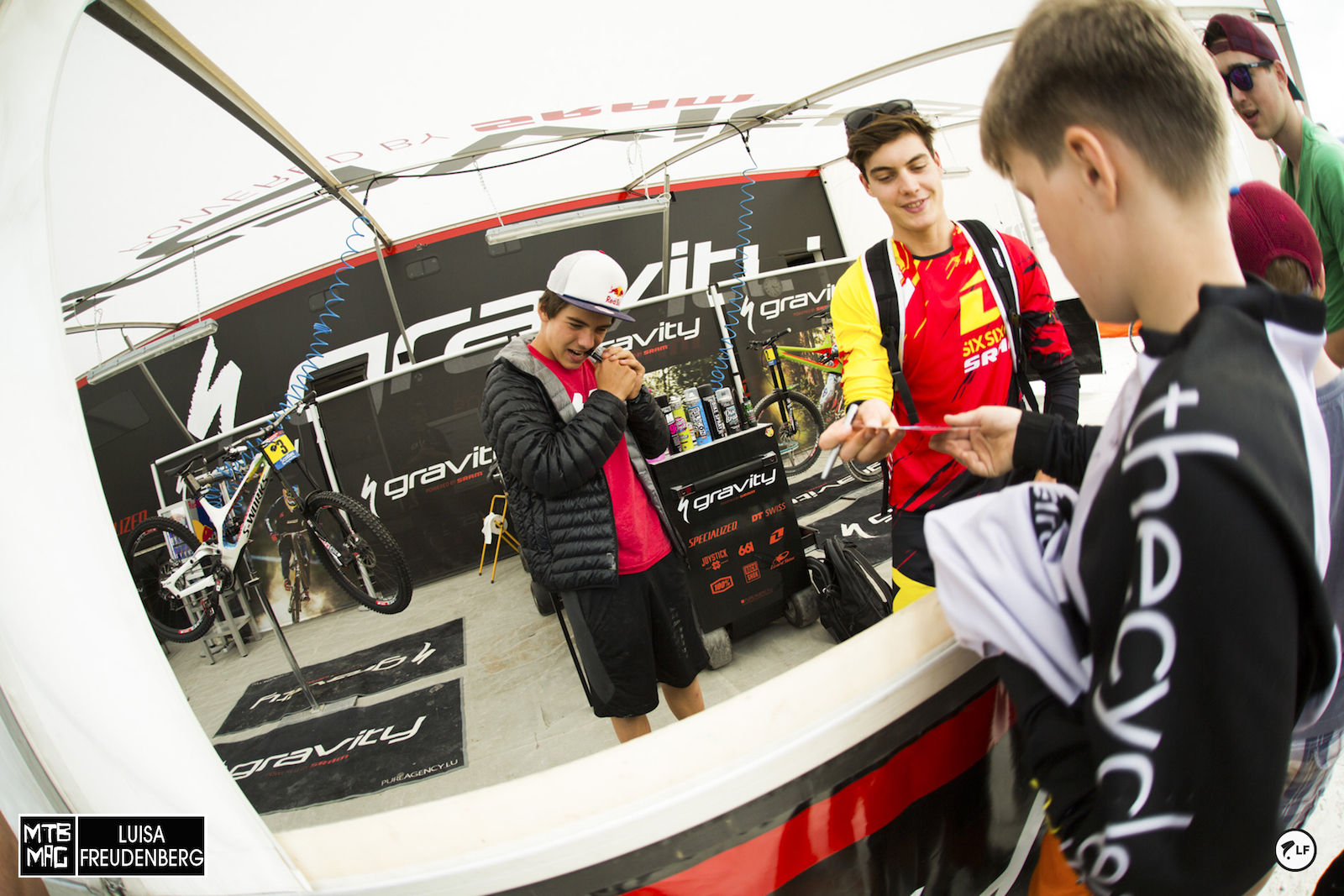 Loris and Finn signing jerseys for the groms.